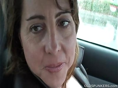Sexy MILF is so horny she plays with her cunt in public